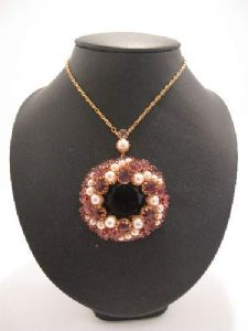 1960's Amethyst crystal and faux pearl circular pendant.